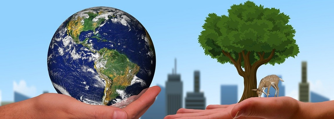 Hand holding the earth and a hand holding a tree with a city backdrop